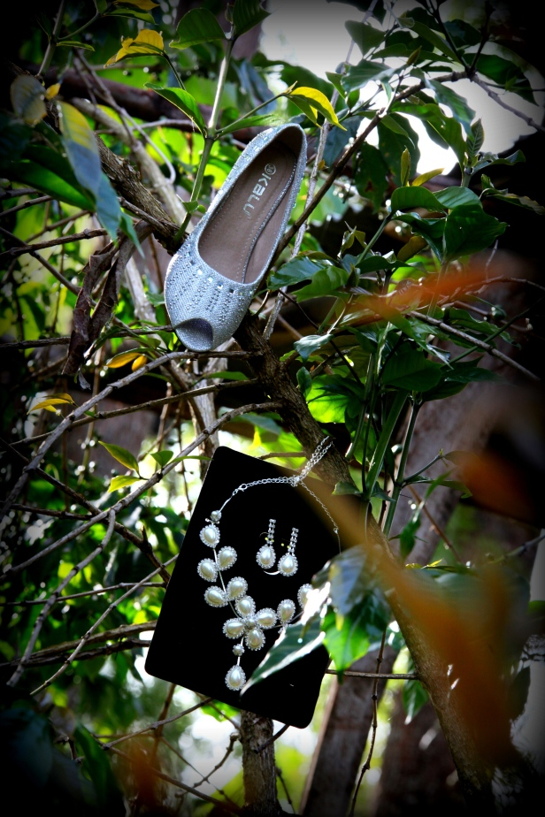 In the cool of the morning at the coffee garden, her shoes and jewelry were on point