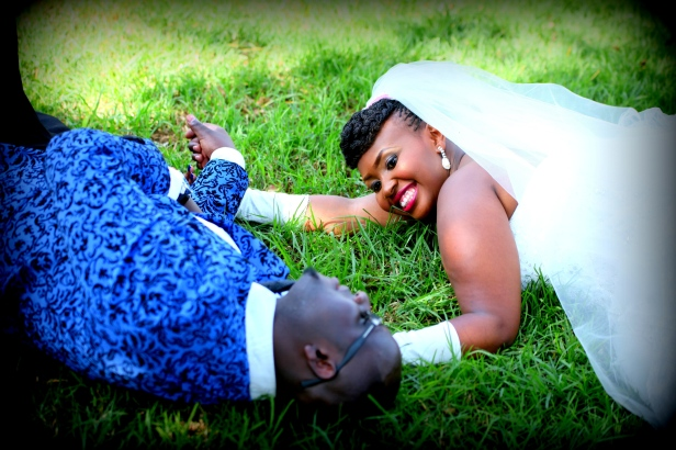 Lying on the ground smiling to each other. The love is blossoming every second.