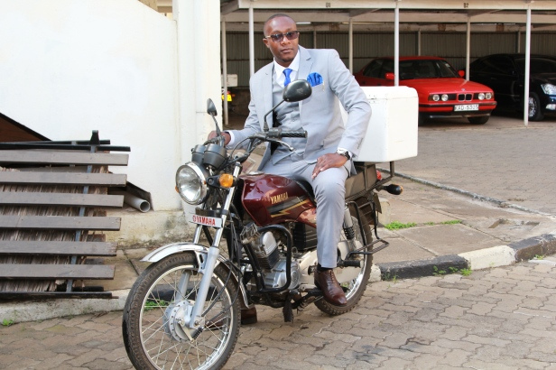 Don't confuse him for a delivery guy. He was ready to carry the groom all the way to the church.